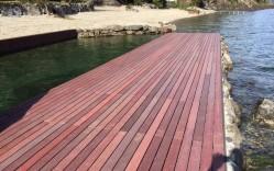 Deck reciclado en Muelle de Panguipulli / Timber Ecco