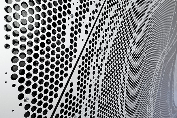 Borupgaard Gymnasium, Ballerup, Denmark. Architect: Sweco Architects. Artist: Helle Hove. Build in 2012 Material: Aluminium EN 5005. Thickness: 3 mm. Pattern: Picture perforation with holes of R20, R15, R10 and R5. Surface treatment: Anodising Application: Facade Sheets produced by RMDK Picture received from Gain. Ordered by RMIG.